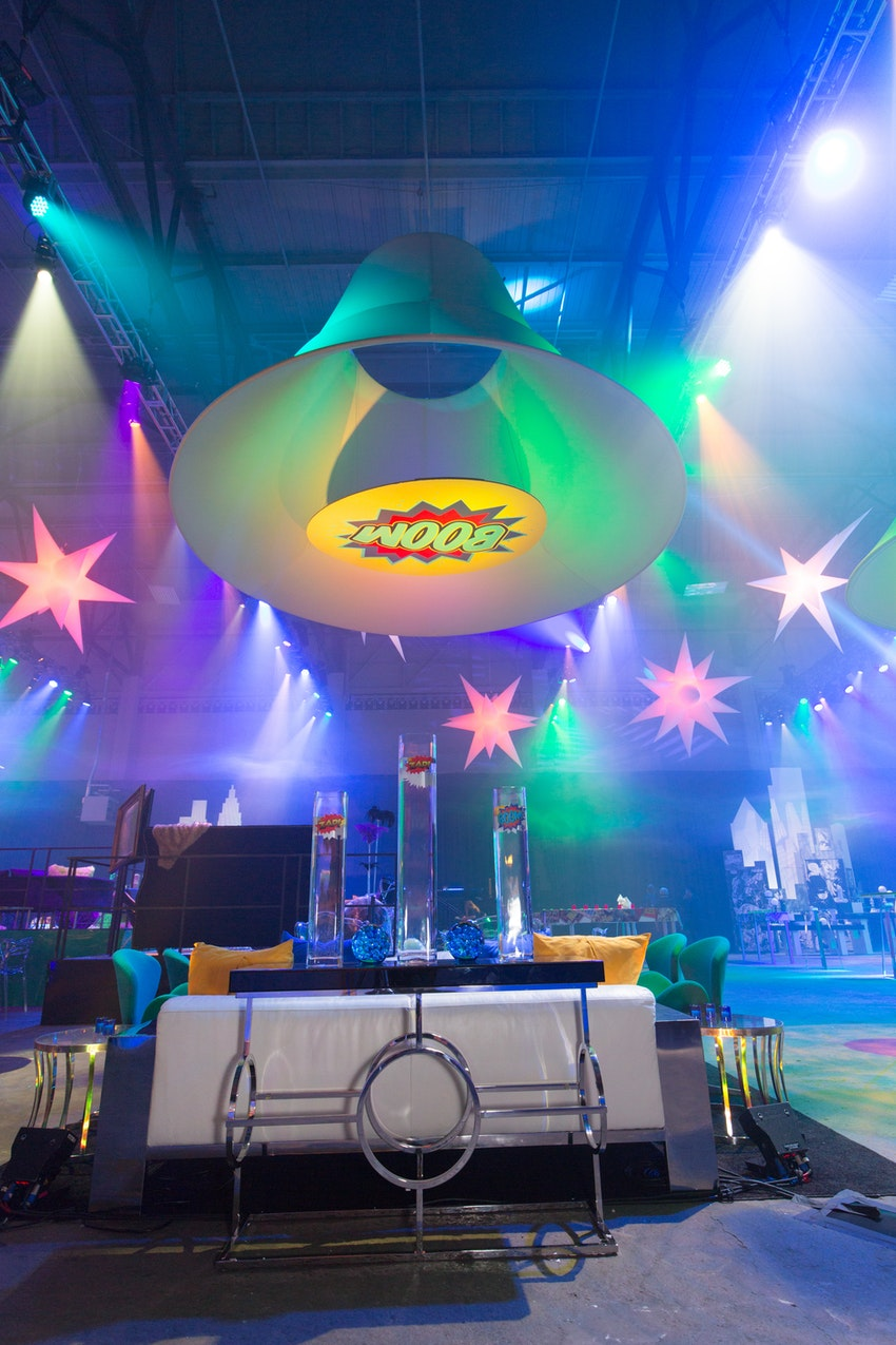 "Hovering shades were placed from the ceilings of the venue and designed with iconic superhero designs and wording, such as this one here with the word ""BOOM!' loud and bold for everyone to see."