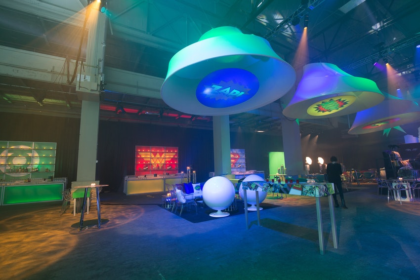 A glimpse of the overall room for this superhero vs. villains themed corporate anniversary party.