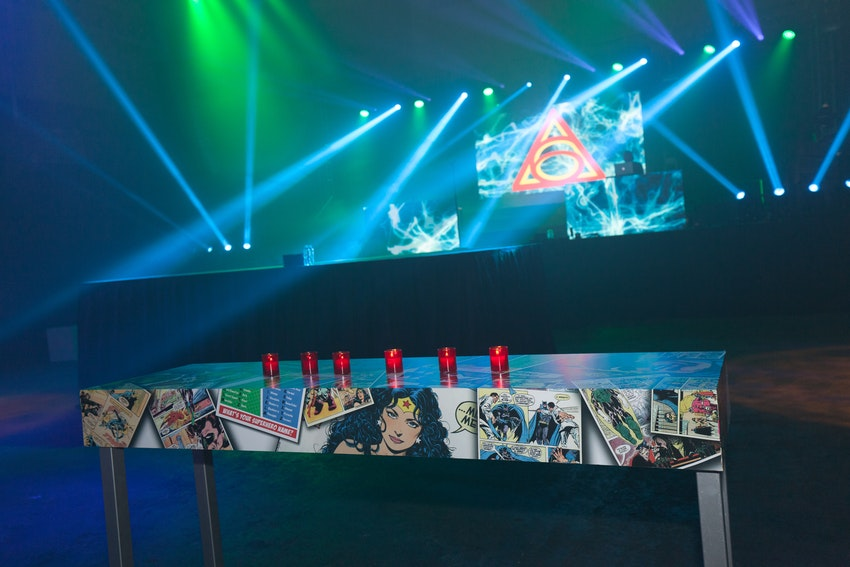 This comic book designed table by Kehoe was a perfect touch to go along with this superheroes vs. villains theme, along with the background screen on stage looking like an effect coming straight out of the next Marvel movie!