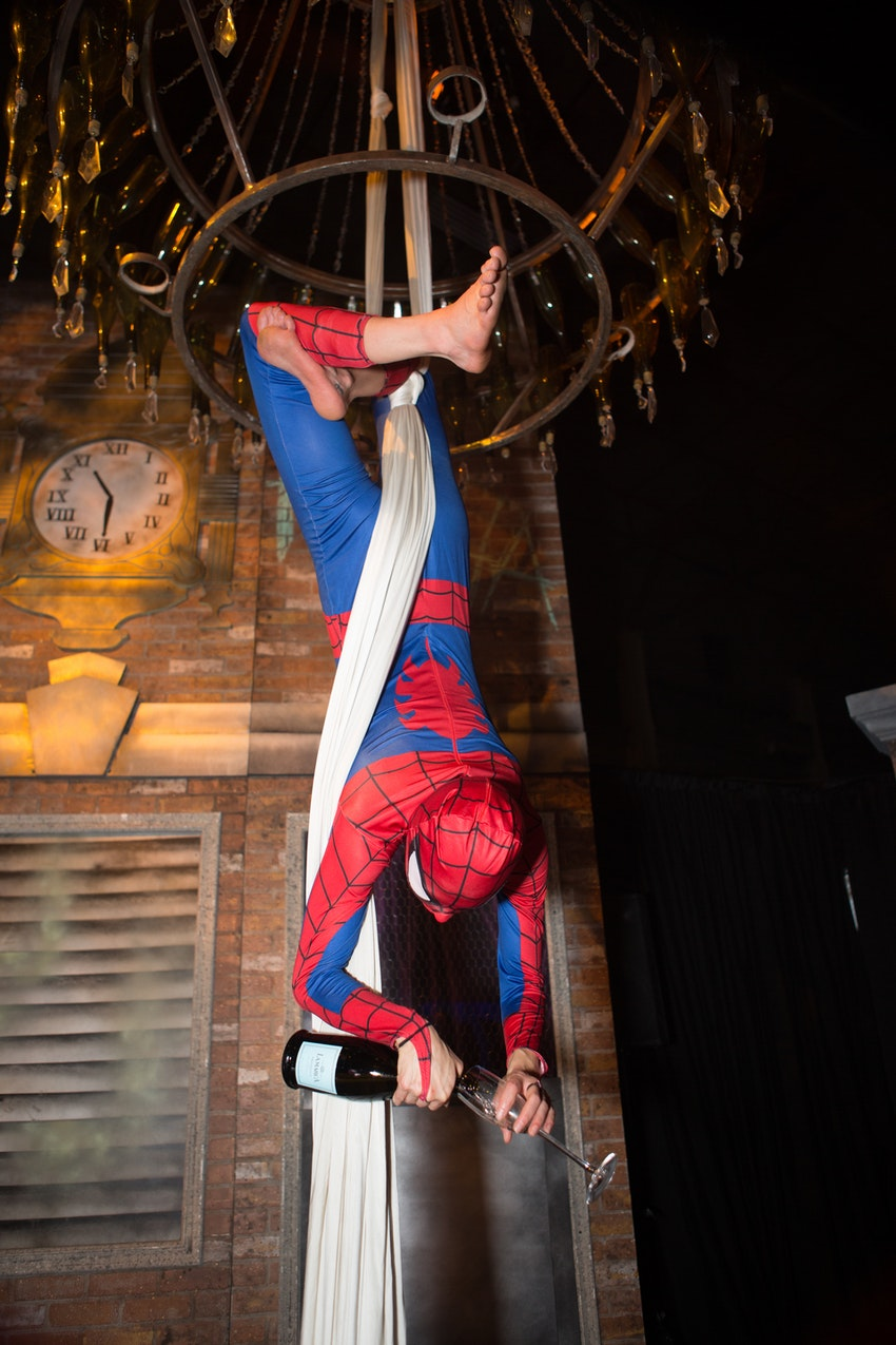 New Moon provided a champagne chandiler complete with an acrobat dressed up just like Spiderman. Being able to climb up and down the ropes like Spiderman himself pouring champagne for guests as they entered their corporate party.
