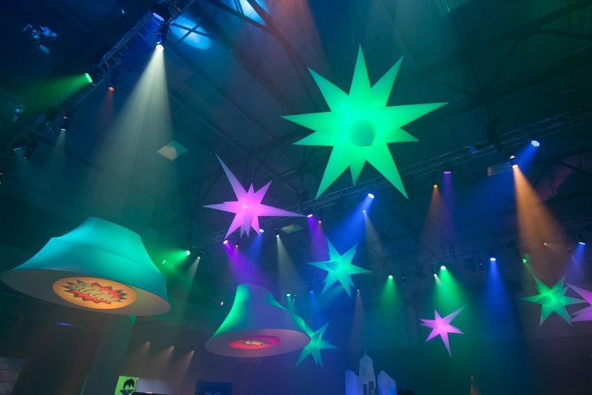 Colorful blow-up stars hung from the ceiling and lit the venue up beautifully for this corporate anniversary party.