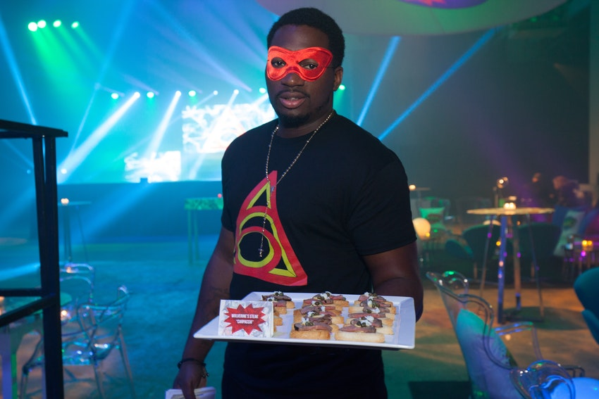 J&L Catering wait staff was dressed in the PEAK6 superhero logo T-shirts along with eye masks to help go along with the superhero vs. villains costume theme, but not so much as to where they could blend in and get lost amongst the crowd.