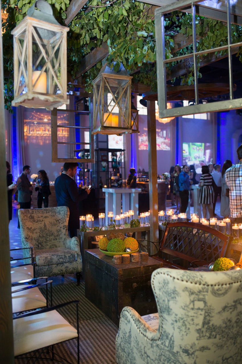 In the main room of this event there was a sectioned bar and lounging area for guest created by Tablescapes.