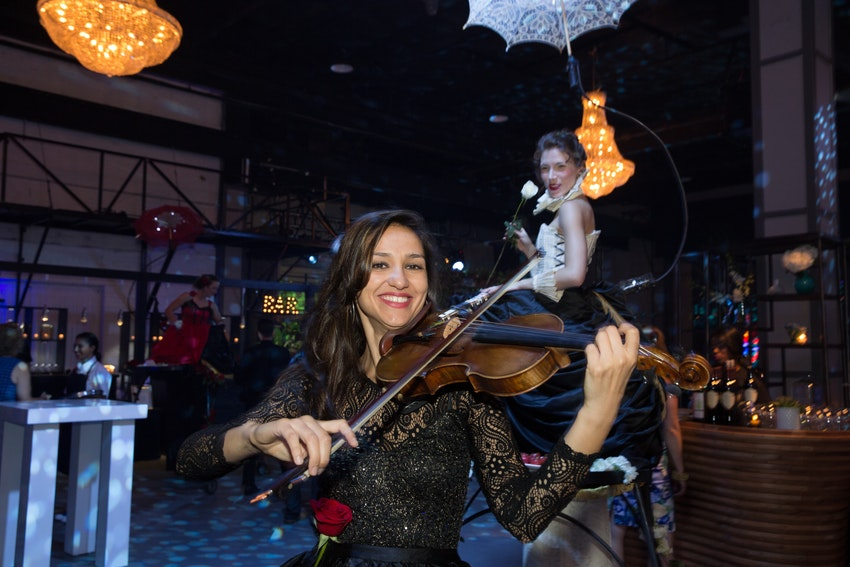 A violinist coasted about the main room to entertain guest during this website launch party.