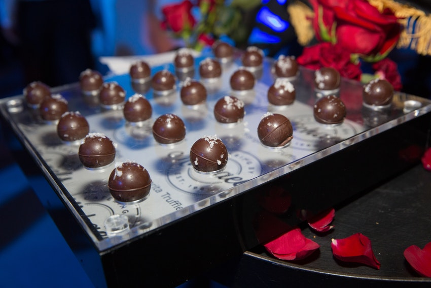 Chocolate cover cake pops were one of the delicious desserts passed around during this website launch party.