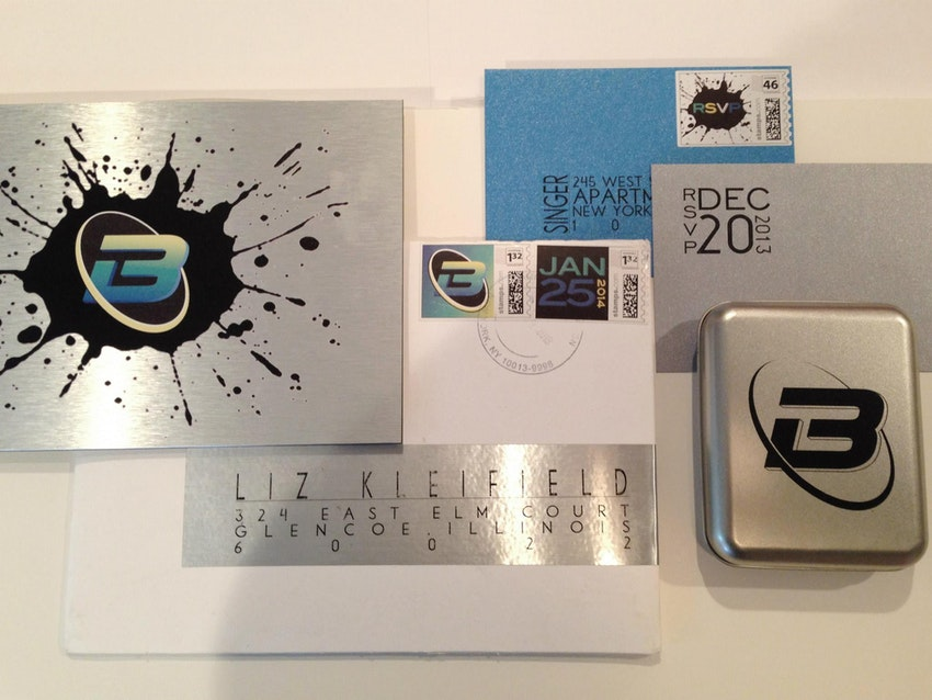 Main invitation printed on brushed aluminum. Custom envelope, label and stamp.