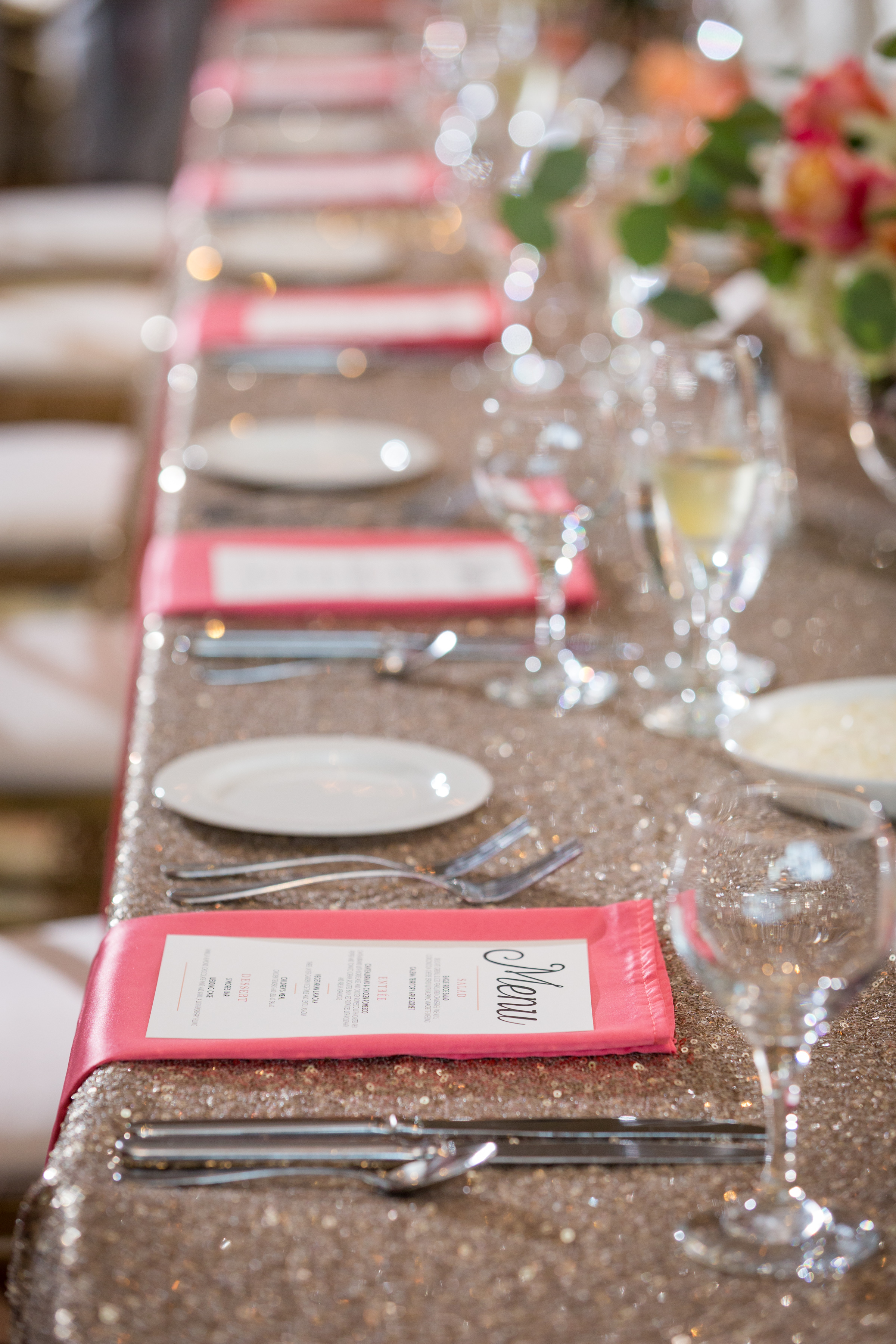 Menu cards on a glitter tablecloth at a real Noted Design wedding.