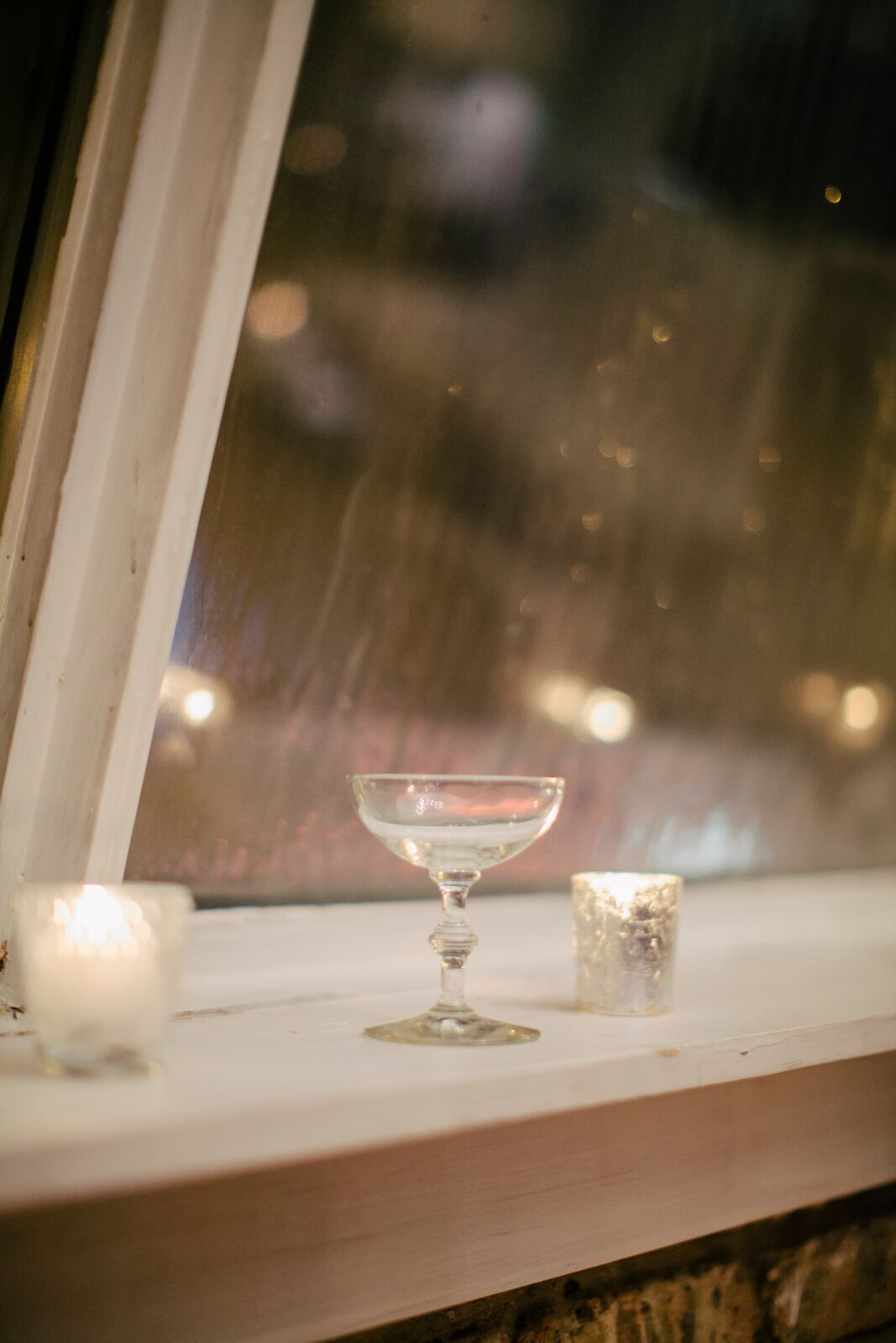 Rain falling on Chicago while ladies drink champagne inside the beautiful DL Loft event space.